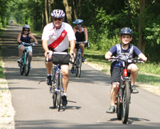 Photo of a family bicycling on the trail.