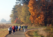 Autumn photo of people walking on ther Pumpkinvine Nature Trail