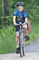 Photo of a boy riding a bicycle