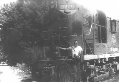Photo of Engineer Haskins standing in front of a diesel locomotive in Shipshewana