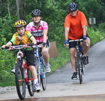 Photo of a family riding bicycles