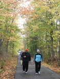 Photo of walkers on the trail on an autumn day