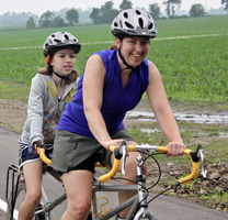 Photo of a mother and daughter riding a tandem bicycle