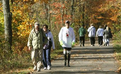 Photo of a disabled man walking on the Pumpkinvine Nature Trail