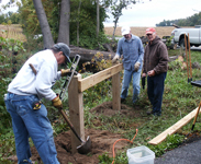 Photo of volunteers building a fence
